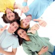 Teenagers lying down with thumbs up — Stock Photo