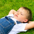 4 years old child lying on the grass. — Stock Photo #10857940