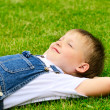 4 years old child lying on the grass. — Stock Photo #10858030