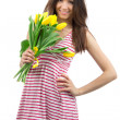 Stock Photo: Womwith yellow tulips bouquet of flowers smiling