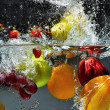 Stock Photo: Fresh Fruit splashing into water