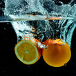 Orange Fruit Splash on water — Stock Photo