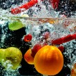 Fruit Splash on water — Stock Photo