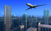 Plane over the city. — Stock Photo