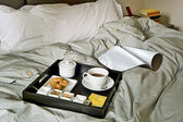 Breakfast tray on the bed in the bedroom — Stock Photo