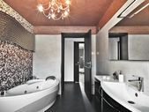 Modern bathroom wit bathtub and washbasin — Stockfoto