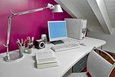 Modern desk in the attic — Stock Photo