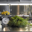 Stock Photo: Spices on steel worktop in modern kitchen