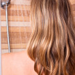 Woman with highlighted hair in shower — Stock Photo