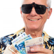 Happy rich elderly man with money — Stock Photo