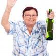 Elderly drunk woman with bottle of alcohol — Stock Photo