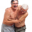 Laughing seniors fighting for fun — Stock Photo #11855059