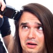 Unhappy man being shaved with hair trimmer — Foto Stock
