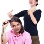 Man shaving his hair and woman laughing at him — Stock Photo #11991659