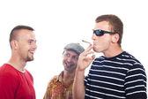 Happy guys smoking hashish — Stock Photo