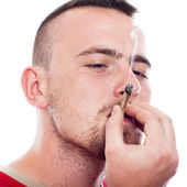 Young man smoking hashish — Stock Photo