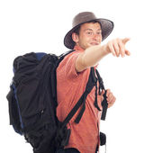 Backpacker pointing the way — Fotografia Stock