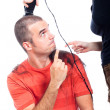 Funny hairdresser shaving man hair - Stock Photo
