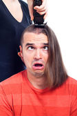 Close up of shocked long haired man being shaved — Stock Photo