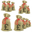 Bags of money with Pounds Sterling — Stock Photo