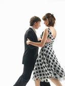 Young couple dancing the tango, white background — Stock Photo