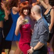 Sexy couple dancing, flirting in night club — Stock Photo