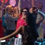 Woman dj entertaining crowd in night club — Stock Photo #11842436