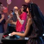 Woman dj entertaining crowd in night club — Stock Photo #11842467