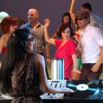 Woman dj entertaining crowd in night club — Stock Photo #11842552