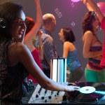 Woman dj entertaining crowd in night club — Stock Photo