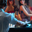 Women flirting with dj in night club - Lizenzfreies Foto