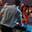 Women flirting with dj in night club - Stock Photo