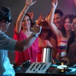 Dj playing music in night club — Stock Photo #11842689