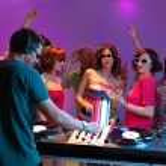 Dj playing music in night club — Stock Photo #11842777