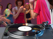 Dj's turntable closeup in a night club — Stock Photo