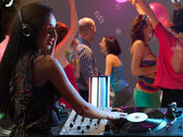 Woman dj entertaining crowd in night club — Stock Photo