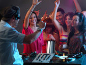 Dj playing music in night club — Stock Photo