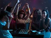 Women flirting with dj in night club — Stock Photo
