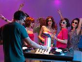 Dj playing music in night club — Stock Photo