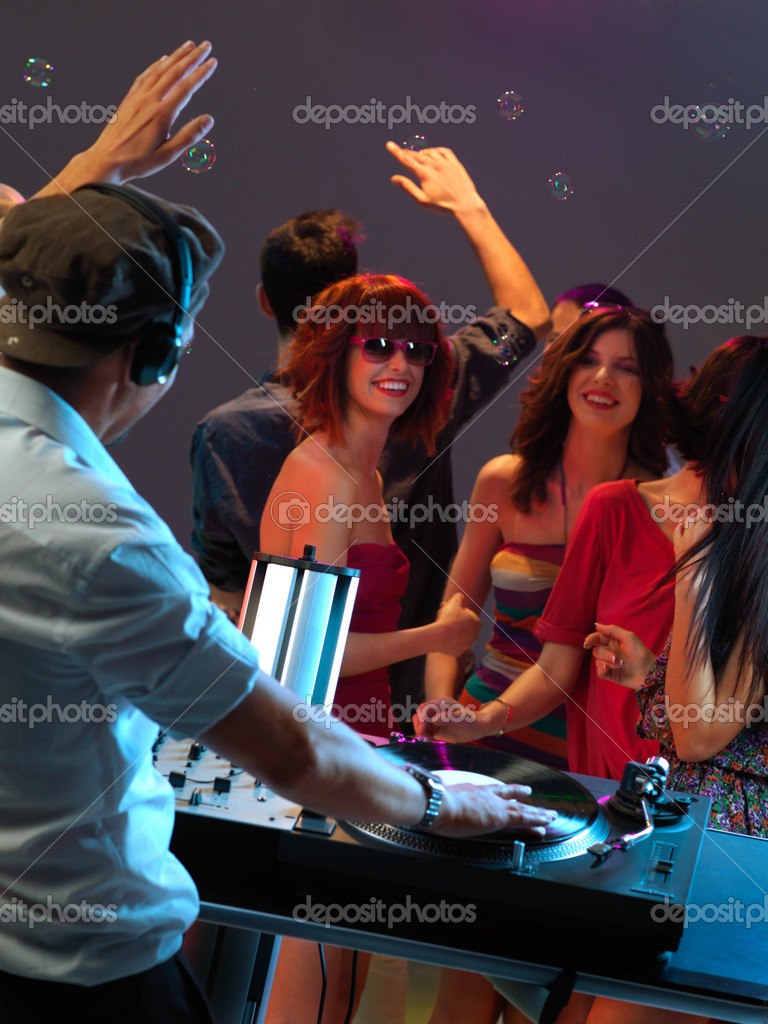 Dj entertaining the happy, dancing crowd in a night club — Stock Photo #11842612