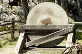 Antique millstone — Stock Photo
