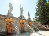 Sculptures on the cascade Gold Mountain in Peterhof. St. Petersb — Stock Photo