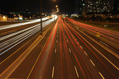 Highway traffic at night time — Stock Photo