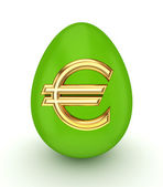 Green egg with a golden euro sign. — Stock Photo