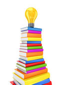 Yellow lamp on a big stack of colorful books. — Stock Photo