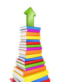 Green arrow on a colorful stack of books. — Stock Photo