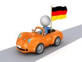 3d-kleine persoon op oranje auto met duitse vlag. — Stockfoto