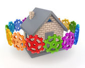 Colorful gears around small house. — Stock Photo