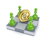 Green pawns around AT symbol. — Stock Photo