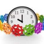 engranajes coloridos alrededor de reloj grande — Foto de Stock